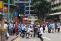A group of government supporters clash with local residents outside Fortress Hill MTR station on Saturday. Photo: Facebook