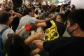 A fight breaks out between pro-Beijing supporters and anti-government protesters in Amoy Plaza shopping centre in Kowloon Bay on Saturday. Photo: Sam Tsang
