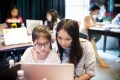 Michelle Sun, CEO of First Code Academy, with children in her coding school. Photo: Handout