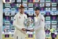 England captain Joe Root (left) and Australia skipper Tim Paine hold the Ashes trophy during the presentation ceremony on the fourth day of the fifth Ashes test. Photo: AFP