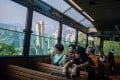 Passengers on the Peak Tram look at the Hong Kong skyline. The city's tourism industry is experiencing its sharpest downturn since the Sars epidemic in 2003. Photo: Bloomberg