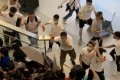 White-clad men attack travellers and passers-by at Yuen Long station on July 21. Photo: SCMP Pictures