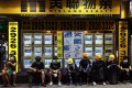 Protesters sit outside a closed real estate agent shop during a rally in Hong Kong on August 3. Photo: EPA-EFE