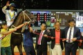 Hong Kong Bet celebrates a win on July 10 with co-owners, including Junius Ho (right). Photo: Kenneth Chan