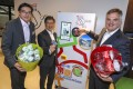From left, William Yu, chief executive of World Green Organisation, Sunny Cheung, CEO of Octopus Cards, and Neil Waters, executive director at Swire Coca-Cola, at the launch of the reverse vending machines in Hong Kong on Thursday. Photo: May Tse
