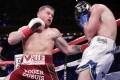 Canelo Alvarez punches Rocky Fielding. Photo: AP