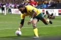 Marika Koroibete scores Australia's fifth try. Photo: Reuters