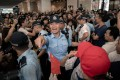 Hong Kong police officers try to separate the flag-waving Beijing supporters from pro-democracy protesters outside a shopping mall in Tsim Sha Tsui on September 18. Photo: AFP