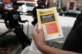 A heroin user reads an alert on fentanyl in New York City. Photo: Getty Images