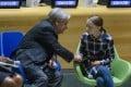 Swedish environmental activist Greta Thunberg shakes hands with UN Secretary-General Antonio Guterres. Photo: AP Photo