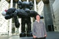 American artist Brian Donnelly, also known as Kaws, poses with his seven-metre tall bronze sculpture called 'Gone' during the 'Kaws: Companionship in the Age of Loneliness' exhibition at the National Gallery of Victoria in Melbourne, Australia, last week. Photo: EPA