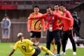 Guangzhou Evergrande remain top of the CSL, but the gap is just one point after defeat against the league's new boys last weekend. Photo: AFP
