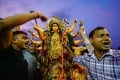 Devotees celebrating Durga Puja in front of a statue of the goddess Durga. Photo: Alamy