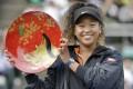 Naomi Osaka won the Toray Pan Pacific Open tennis tournament on Sunday. Photo: Kyodo News via AP