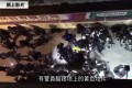The video, filmed from above, claims to show at least 20 riot police surrounding a man in a yellow vest and one officer kicking him. Photo: RTHK