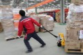 A worker moves goods at a JD.com logistics centre in Langfang, a city in the Chinese coastal province of Hebei. Photo: Reuters