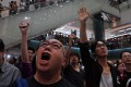 People sing Glory to Hong Kong in a shopping mall in the city earlier this month. Crowds have gathered in several malls to sing the song, which has become the anthem of anti-government protests that have rocked Hong Kong since June. Photo: AP