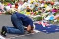 A Muslim worshipper prays at a makeshift memorial at the Al Noor Mosque in Christchurch. Photo: EPA
