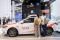 Attendees look at a DiDi Chuxing autonomous vehicle at the World Artificial Intelligence Conference (WAIC) in Shanghai, China, on Thursday, Aug. 29, 2019. Photo: Bloomberg