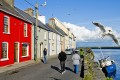A row of brightly painted houses facing Galway Bay known as the Long Walk, in Galway, Ireland. Photo: Tim Pile
