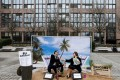 Activists stage a protest against the backdrop of a mock tropical island beach representing a tax haven, outside a meeting of European Union finance ministers in Brussels, Belgium, in December 2017. Improved corporate disclosures include recognising the sustainability impacts and relevance of issues such as tax payments. Photo: Reuters