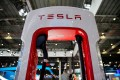 A Tesla charging station at a Shanghai car show. The American electric vehicle maker is set to start production by the end of this year in its wholly owned manufacturing plant in Shanghai. Photo: Reuters