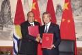 Kiribati's President Taneti Mamau (left) shakes hands with Chinese Foreign Minister Wang Yi. Photo: Xinhua