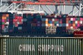 Shipping containers from China and other Asian countries are unloaded at the Port of Los Angeles, on September 14. Photo: AFP