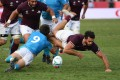 Georgia's Zura Dzneladze (right) is tackled by Uruguay's scrum-half Santiago Arata. Photo: AFP