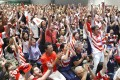 Japan supporters at a public viewing site in Tokyo celebrate after Kenki Fukuoka scored a try. Photo: Kyodo