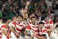 Japan players celebrate after defeating Ireland 19-12 in their pool A match at the Rugby World Cup at Shizuoka Stadium. Photo: AP