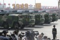 Military vehicles carry DF-17 missiles capable of reaching the US mainland during the parade to mark 70 years of the People's Republic. Photo: AP