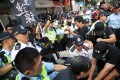 Clashes involving members of the League of Social Democrats on National Day in Wan Chai. Photo: Winson Wong