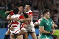 Japan's rugby players celebrate after their shock victory over Ireland on September 28. Japan is having a successful stint as host of the World Cup but its economy is in a ruck. Photo: Reuters