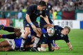 Scotland wing Darcy Graham is tackled during their Rugby World Cup Pool A match against Samoa at the Kobe Misaki Stadium. Photo: AFP