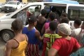 Some of the women who were freed by police are seen entering a vehicle in Lagos, Nigeria, on Monday. Photo: Reuters