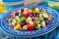 For a healthy salad, keep it simple with a tasty mix of ingredients such as in a greek salad with feta cheese, kalamata olives, cucumber, peppers, onion, and tomato. Photo: Alamy