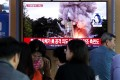 People in Seoul watch coverage of North Korea's missile launch. Photo: AP
