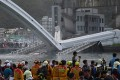 Rescuers at the scene of the collapsed bridge on Tuesday. Photo: AFP