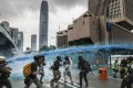 A police water cannon is used on protesters in Admiralty on August 31, against the backdrop of iconic buildings in Hong Kong's central business district. Photo: Sam Tsang
