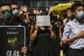 Protesters hold a flash mob rally at Chater Garden in Central on October 2, in support of a Secondary Five student who was shot by a police officer during scuffles following a mass rally the previous day, the 70th anniversary of the founding of the People's Republic of China. Photo: Sam Tsang
