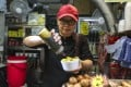Ms Yip of Mum's Bean Curd Pudding in Mong Kok prepares a bowl of fish balls. Photo: Xiaomei Chen