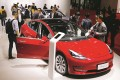 Visitors inspect a Tesla Model 3 during the media day at the Auto Shanghai 2019 motor show in Shanghai, China. Tesla is building a factory in the city. Photo: EPA