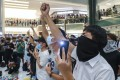 Protesters gather and sing at New Town Plaza mall in Sha Tin on October 2 in support of the 18-year-old protester shot by a police officer the day before. Photo: Sam Tsang