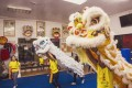 Cassandra Liu (left) looks on during a lion dancing rehearsal by the Shaolin Entertainment Lion Dance Troupe, owned by Shaolin kung fu master Bruce Wen, in California, United States. Photo: Jon Delouz