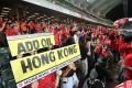 Fans hold up a sign during Hong Kong's Asian World Cup qualifying match against Iran at Hong Kong Stadium in September. Photo: Felix Wong