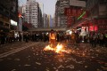 Anti-government protesters set a fire in Causeway Bay, Hong Kong. Photo: Winson Wong