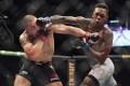 Robert Whittaker is hit by Israel Adesanya at UFC 243. Photos: AP