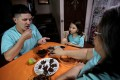 Biologist Federico Paniagua and family eat insects at their farm in Grecia, Costa Rica. Three years ago, he replaced the animal protein in their meals with ants, crickets, cockroaches, beetles and the like, all of which he farms in the Central American country. Photo: Reuters/Juan Carlos Ulate