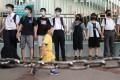 Secondary school students form a human chain in Tsuen Wan. Photo: K.Y. Cheng
